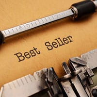 Typewriter with bestseller and most popular book genres