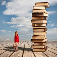 Younger reader look up at book genres for kids